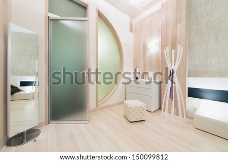 Contemporary bright room decorated tree with mirror and glass door - stock photo