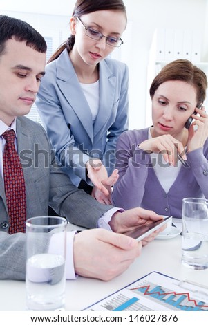 Contemporary business people working in team in the office