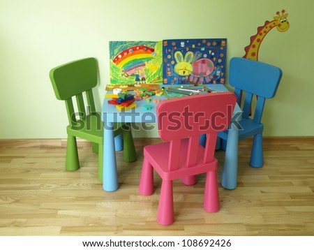 Contemporary children's room equipment, colorful table and chairs - stock photo