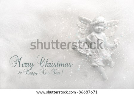 Contemporary christmas card in white and silver with angel - stock photo