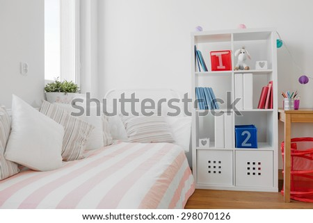 Contemporary decor of children room with bed and book shelf - stock photo