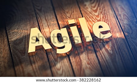 """Contemporary design of business processes. The word """"Agile"""" is lined with gold letters on wooden planks. 3D illustration image for blog article - stock photo"""