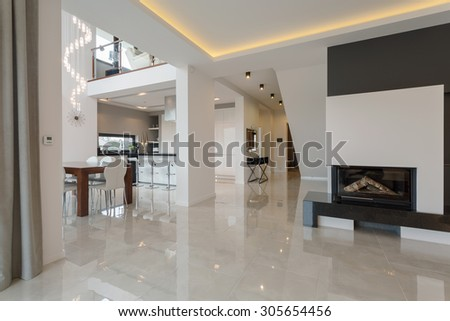 Contemporary designed interior in big expensive house - stock photo