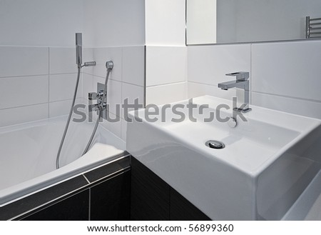 contemporary designer bathroom appliances in minimalist style - stock photo