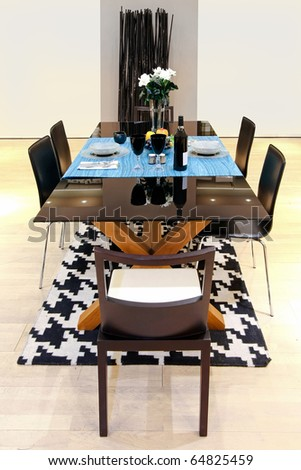 Contemporary dinning room with set up table for twoin - stock photo
