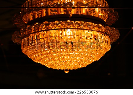 Contemporary glass chandelier  - stock photo