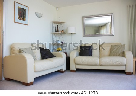 Contemporary home living room with matching sofas. Property released. - stock photo