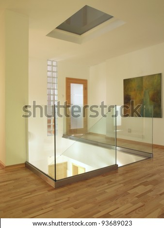 Contemporary interior with wooden floor and glass staircase, - stock photo