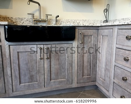 Contemporary Kitchen Cabinets Made Of Natural Wood With Ceramic Sink,  Polished Chrome Faucet And Gray