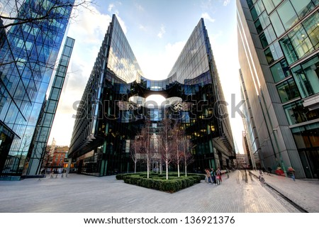 Contemporary London Architecture along the Thames River bank UK - stock photo