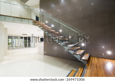 Contemporary mansion with wooden staircase - stock photo
