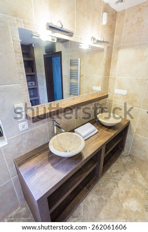 Contemporary marble round basins on wooden units - stock photo