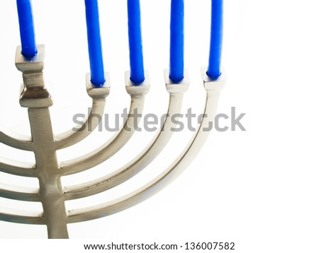 Contemporary menorah with blue candels on white background.