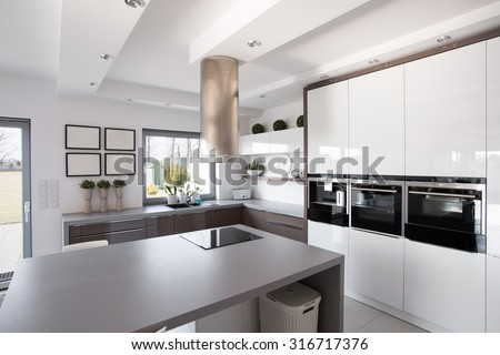 Contemporary minimalistic kitchen in a rich fashionable house - stock photo