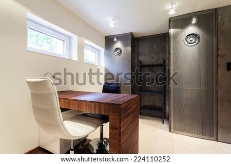 Contemporary office with wooden and metal elements - stock photo