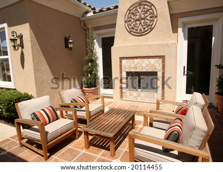 Contemporary outdoor patio with fireplace - stock photo