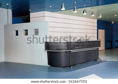 Contemporary reception counter in a hallway of company - stock photo