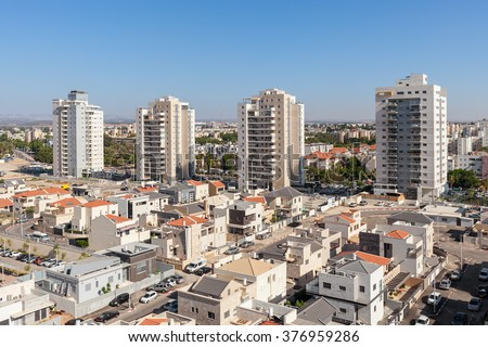 Contemporary residential buildings and houses in new neighborhood of Kiryat Gat, Israel. - stock photo