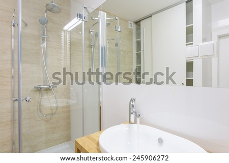 Contemporary shower with glass door in new washroom