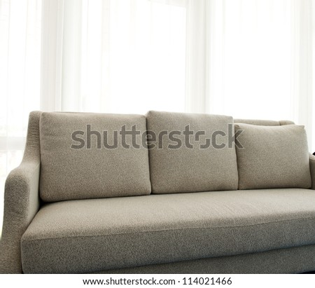 Contemporary sofa in a modern living room. - stock photo