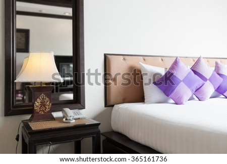 contemporary thai style hotel bedroom. - stock photo
