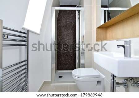 Contemporary three piece ensuite bathroom with shower cubicle and mosaic tiles - stock photo