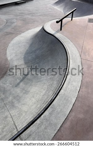 contemporary urban design concrete skatepark - stock photo
