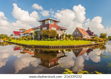 Contemporary villas alongside a pond in the province of Friesland, The Netherlands - stock photo