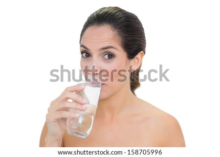Content bare brunette drinking glass of water on white background - stock photo