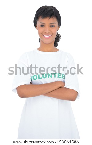 Content black haired volunteer posing with crossed arms on white background - stock photo