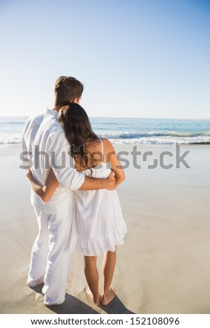 Content couple looking at the waves at the beach - stock photo