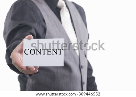 Content. Man holding a card with a message text written on it