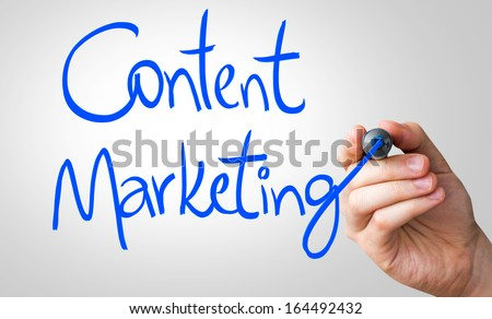 Content Marketing hand writing with a blue mark on a transparent board - stock photo