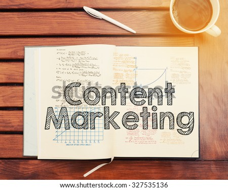 Content Marketing : text inside notebook on table with coffee - stock photo