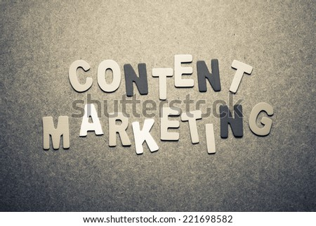 Content marketing word topic in cut wood letter - stock photo