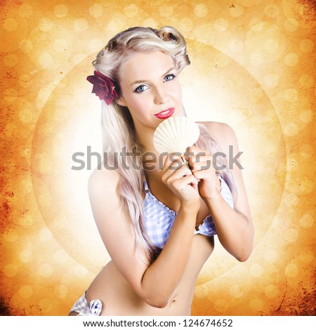 Content Pinup Girl On Peaceful And Relaxing Holiday Holding Shell In Front Of Retro Summer Background, Concept Of Holidays And Travel - stock photo