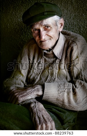 Content senior old man with expressive eyes - stock photo