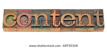 content word in vintage wooden letterpress printing blocks, stained by color inks, isolated on white