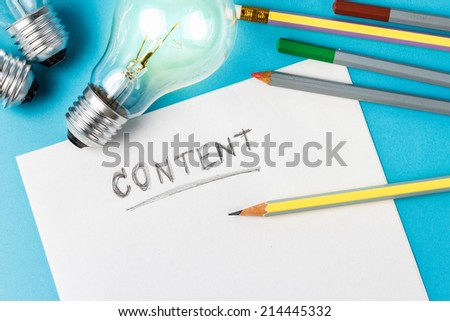 Content writing concept with light bulb as creative symbol - stock photo