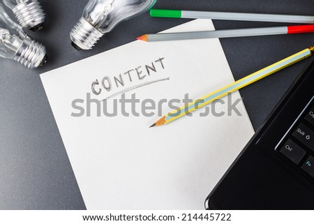 Content writing concept with part of light bulb, pencil,  and laptop - stock photo
