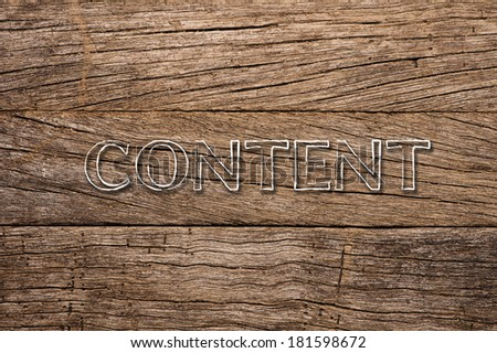 Content  written over wooden background