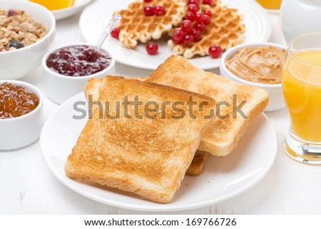 continental breakfast - toast, jam, peanut butter, juice, horizontal - stock photo