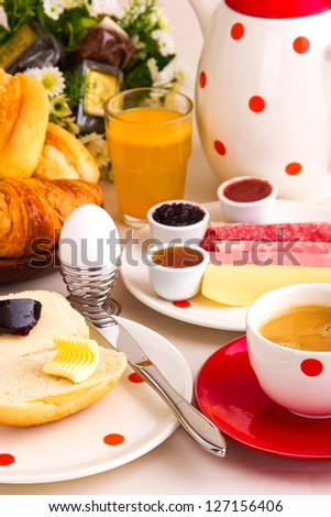 continental breakfast with coffee, cheese,jelly,bread rolls...