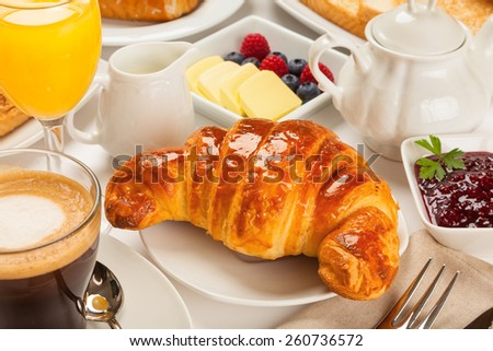 Continental breakfast with croissants, orange juice and coffee or tea - stock photo