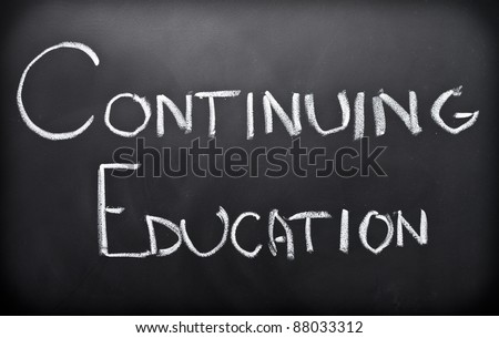 Continuing education written on classroom blackboard - stock photo
