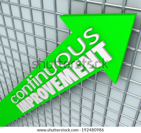 Continuous Improvement words on an arrow aiming upward - stock photo