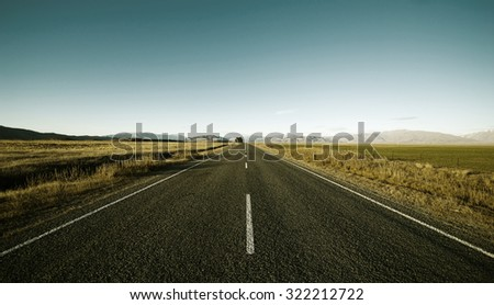 Continuous Road Scenic Mountain Ranges Rural Remote Concept - stock photo