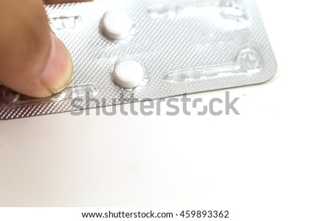 contraceptive pill ,or morning after pill on woman hand,abortion concept. - stock photo