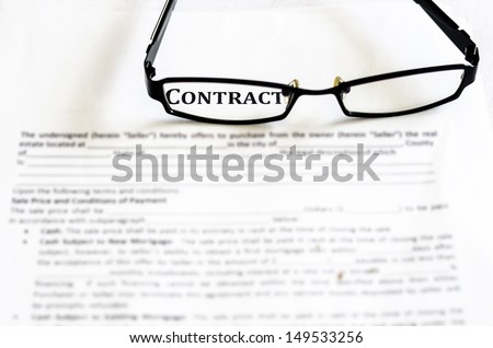 Contract management with business glasses - stock photo