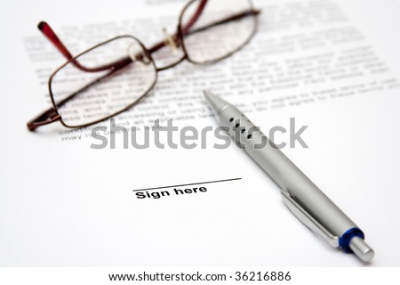 Contract with glasses and pen ready to be signed - stock photo